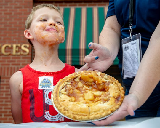 Altoona celebrated its 150th anniversary with several activities held throughout the town July 28. Alexander Terhark, 7, of Mitchelville stood proud of his work winning the youth pie eating contest.