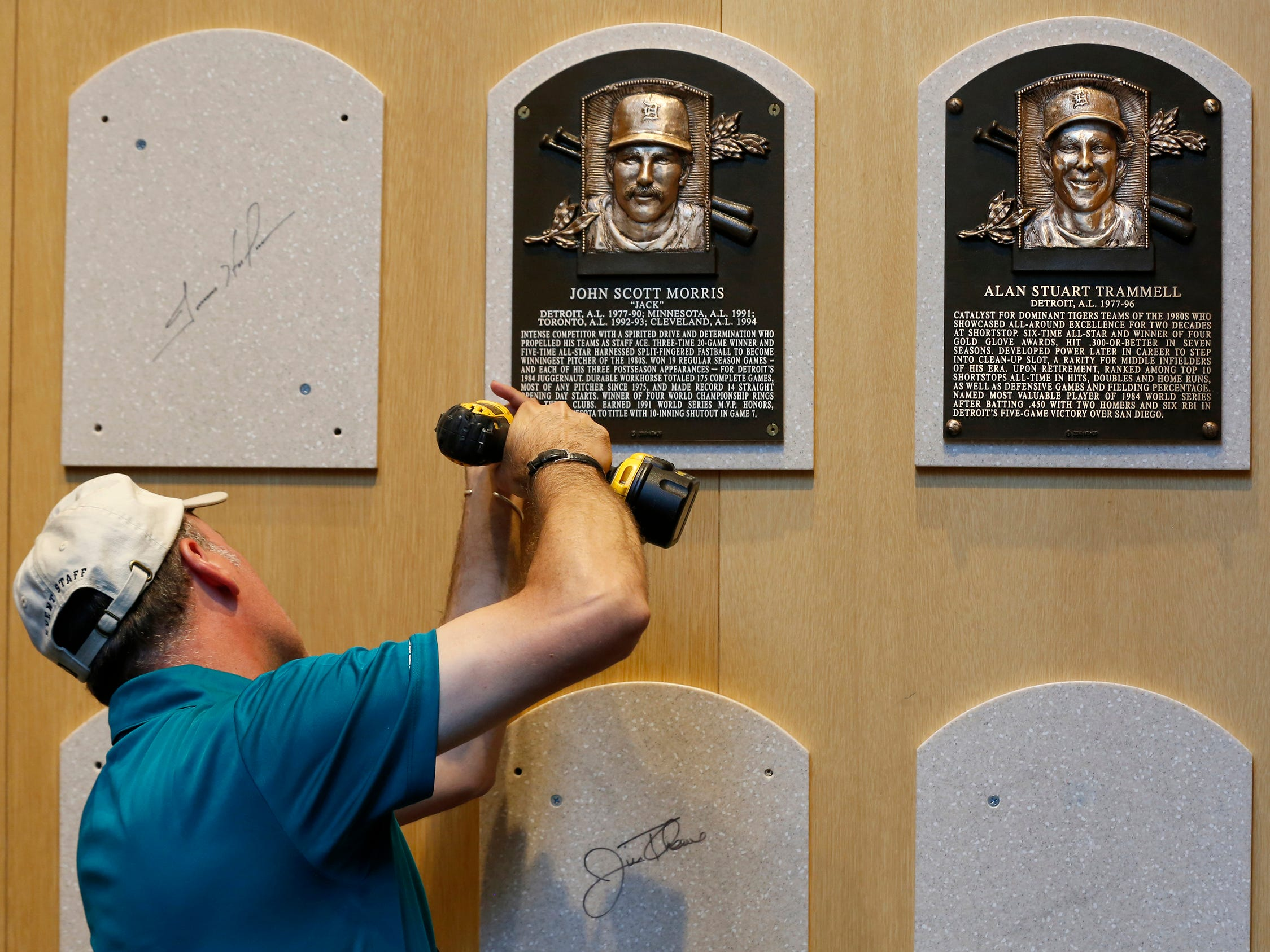 Mike Fink, manager of exhibits at the National Baseball Hall of Fame and Museum in Cooperstown, N.Y., installs the Hall of Fame plaque of former Detroit Tigers star Jack Morris, left, and Alan Trammell on Sunday, July 29, 2018 was over.