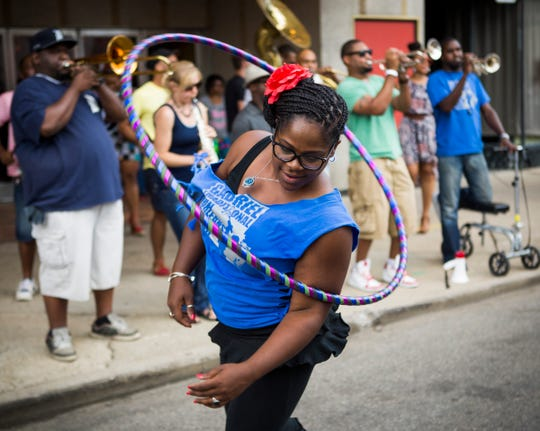A performance can break out anywhere at Sidewalk Detroit.
