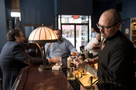 Bartender Rick Paulger prepares a rye whiskey at the Buhl Bar in downtown Detroit, Friday, May 4, 2018.