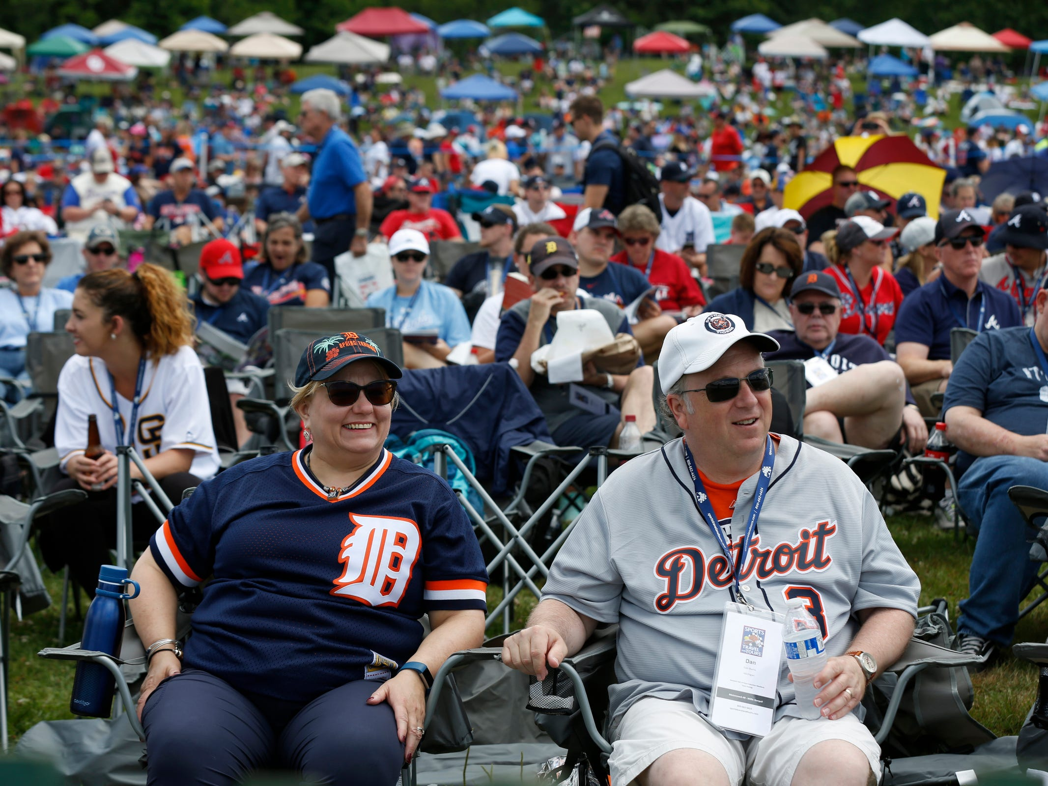 Detroit Tigers fans Julie and Dan Burns of Novi, watch on the large video screen an interview with former Detroit Tigers pitcher Jack Morris, before the induction ceremony at the Clark Sports Center after the National Baseball Hall of Fame induction ceremony in Cooperstown, N.Y. on Sunday, July 29, 2018.