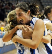 MOLLY BARTELS / Courier & Press Memorial senior Mallory Ladd celebrates with fellow senior, Sarah Stone, after the team's 58-50 win over Benton Central during the Class 3A girls' basketball state championship game at the Allen County War Memorial Coliseum in Fort Wayne, Ind., on Saturday, March 5 2011.  Ladd scored 24 points.