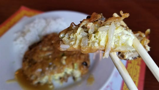 Canton Inn's egg fu young is brown and crisp on the exterior, creamy and eggy inside.