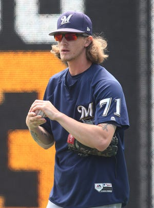 Milwaukee Brewers relief pitcher Josh Hader, seen warming up before a game at Pittsburgh on July 15,  has come under fire for offensive tweets he wrote when he was 17 years old.