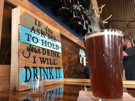 """A sign at Blue Ridge Brewing reads: """"If you ask me to hold your drink I will drink it."""""""