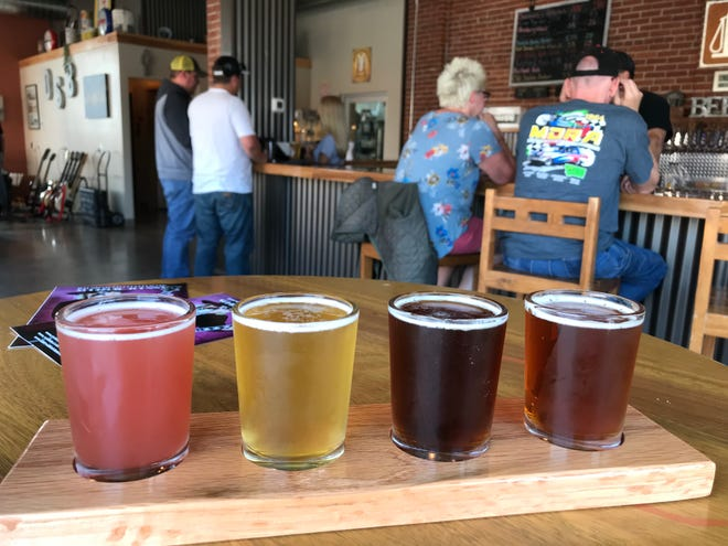 A flight of beer at Havre's new Old Station Brewing Co. includes the pinkish - and delicious - raspberry beer.