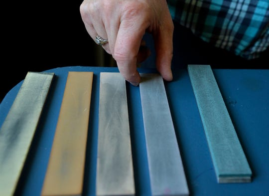 Sonja Bragstad, owner of The Finer Edge by Sonja, shows whetstones, each with a different coarseness, for sharpening knives.