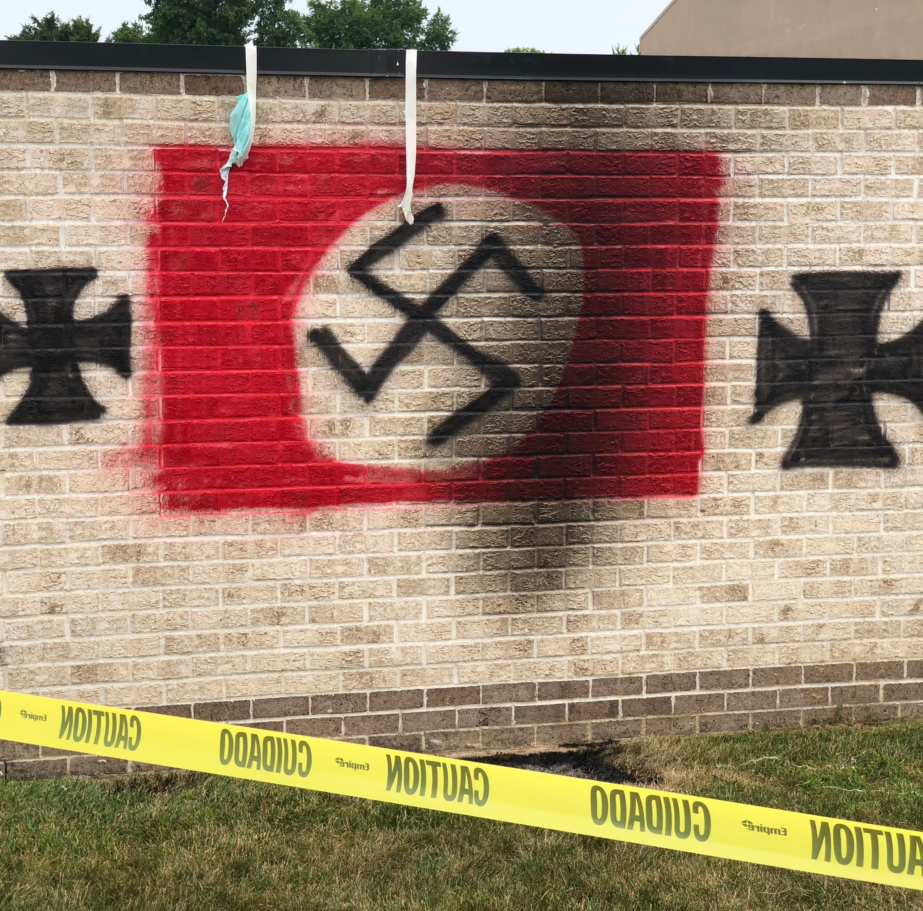 Vandals painted a Nazi flag on a garbage bin shed at Congregation Shaarey Tefilla on West 116th Street in Carmel, Ind.