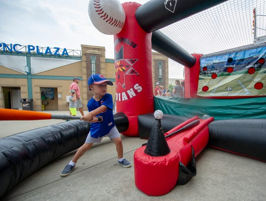 Addington Hennessy, 3, of Noblesville, takes a swing at the batting experience kiosk. Hennessy was celebrating his birthday at today's game. The Indianapolis Indian's hosted the Buffalo Bisons in Minor League Baseball action at Victory Field, Sunday, July 29, 2018. The Tribe lost 2-1 in the front side of a double-header.