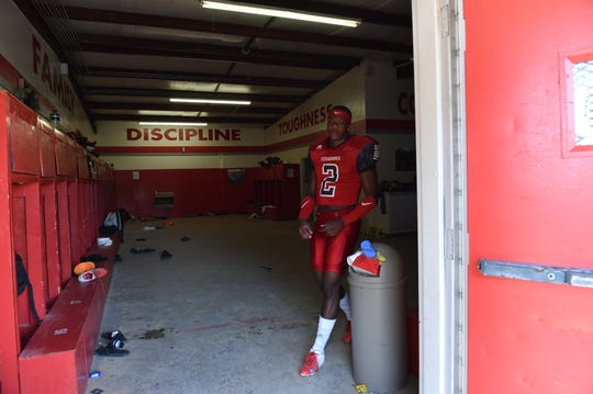 K.J. Jefferson, quarterback for North Panola, walks out of his locker room for team picture day on the football field.  Jefferson is the Arkansas Razorbacks' fourth pledge for the 2019 recruiting class. Tuesday, July 17, 2018.