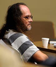 Billy Ray Irick, on death row for raping and killing 7-year-old Paula Dyer, sits in a Knox County courtroom in August 2010 as his attorneys argue he's too mentally ill to be executed by the state.