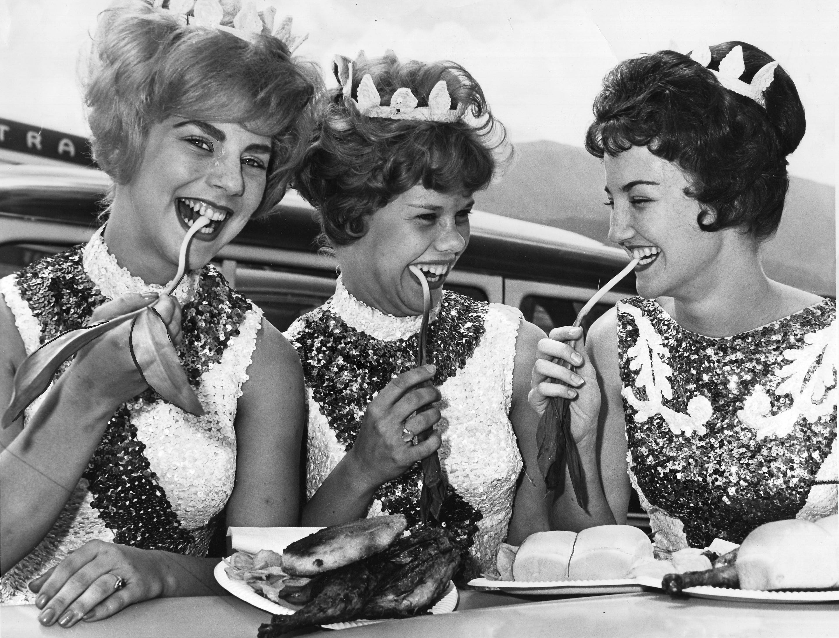 University of Tennessee majorettes DeAnna Smith, left, Mary Nicholon, and Claudette Riley take time out from their high-stepping routines to try the vile-smelling plant during the Ramp Festival on April 29, 1962, in Cosby.