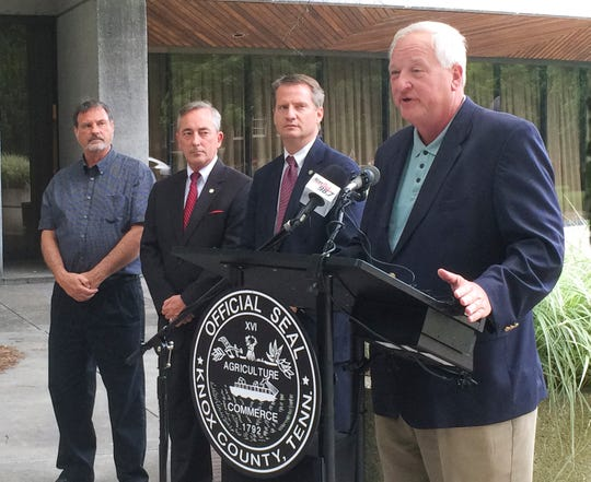 Knoxville Chamber President and CEO Mike Edwards, right, along with Knox County Mayor Tim Burchett, Knox County Commissioners Bob Thomas and Randy Smith announces that the EPA has designated Knox, Blount and Anderson counties as in compliance with federal standards for ground-level ozone Monday at the City County Building. The designation, based upon air-quality monitoring data from 2001, 2012 and 2013, will make it easier to recruit new business and industry to the region.