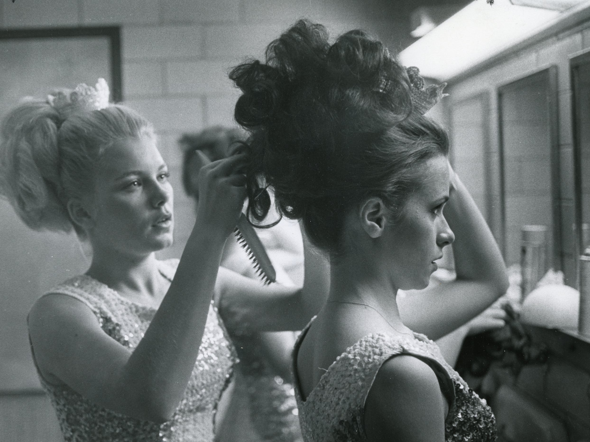 UT majorettes Suzie Smith and Suzanne Minchey get ready to perform, January, 1973.