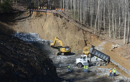 Crews from contractor Phillips & Jordan Inc. work on erosion control while repairing a 200-foot section of U.S. Highway 441 on Feb. 27, 2013, in the Great Smoky Mountains National Park.