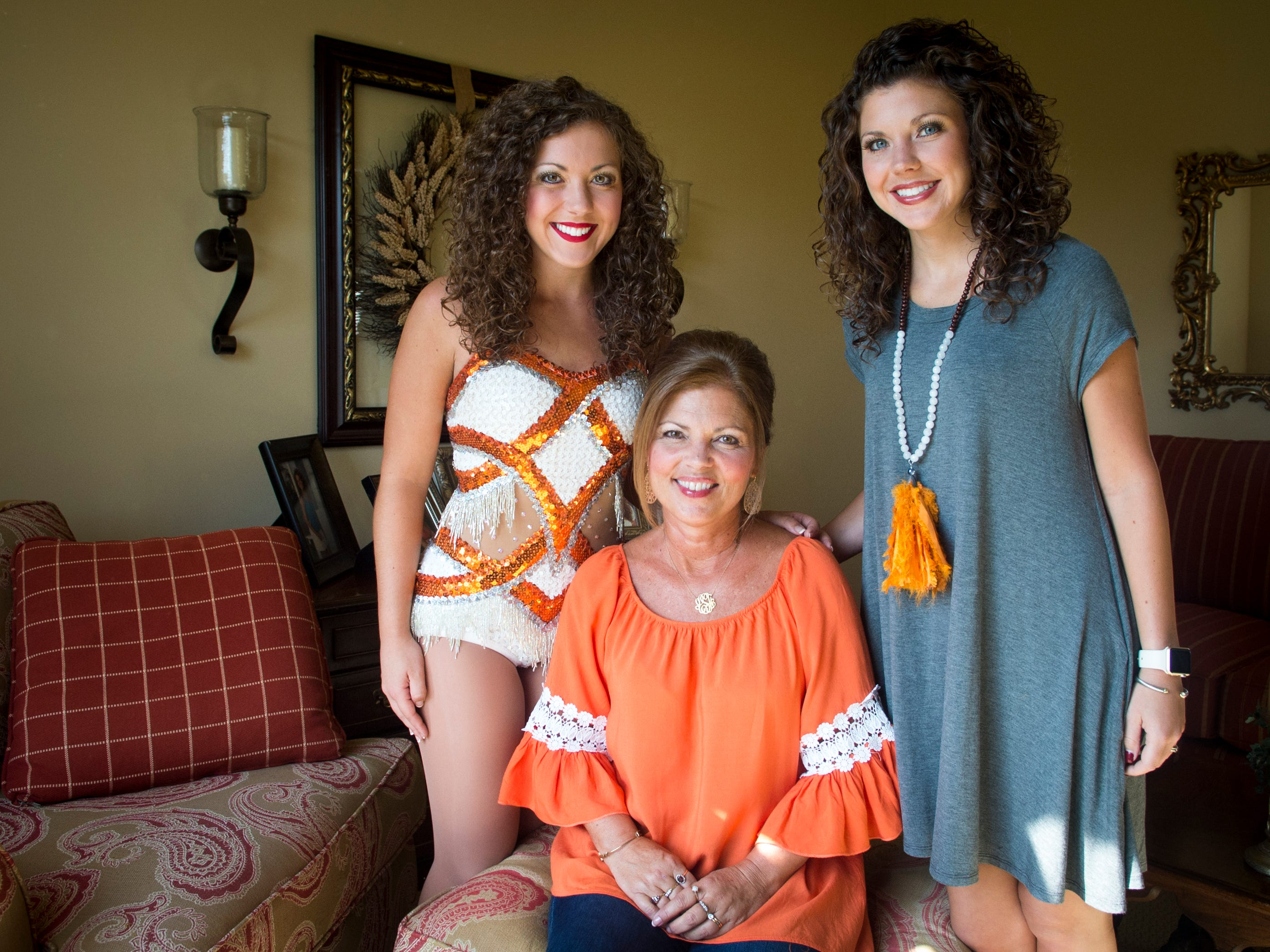 UT Majorette Kari Summers, left, is pictured with her mother Leigh Ann Summers, center, and sister Kristi Summers, right, at their home in Knoxville on Monday, Oct. 31, 2016.  All three women were UT Majorettes and will march together during UT's homecoming game.