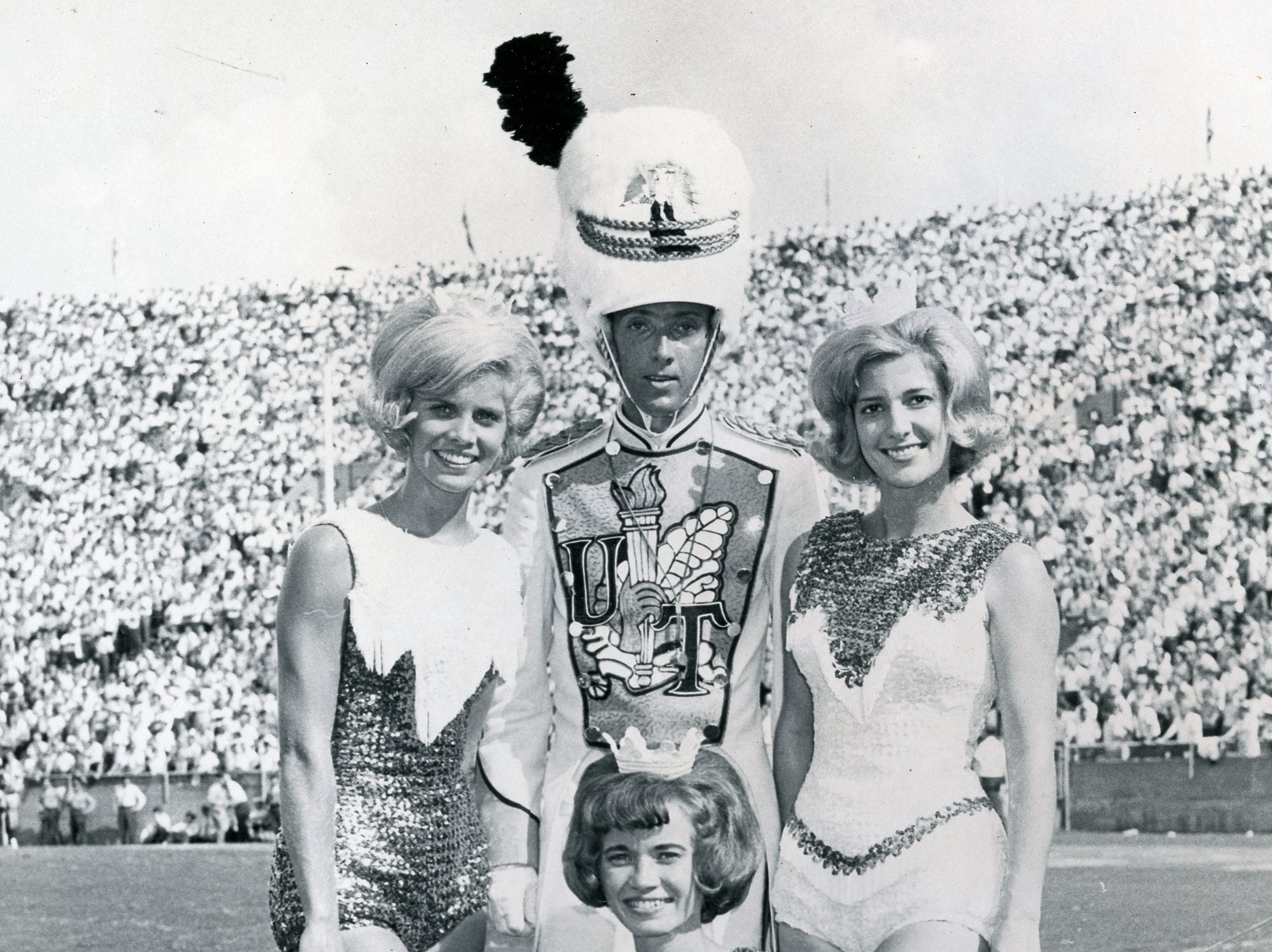 UT majorettes (front) Mary Kay Bettis; (back) Judy Barton and Brenda Flowers with drum major Russell Ramsey (center). September 1965.