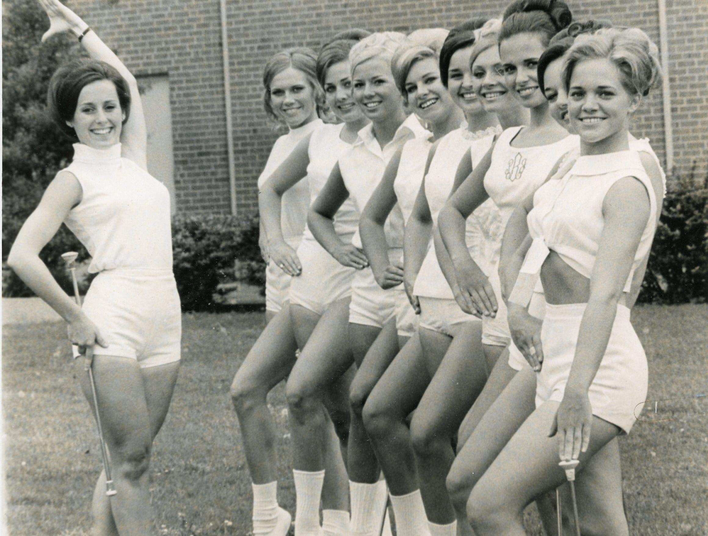 UT head majorette Pete Payne with Gail Noe, Deborah Holiday, Donna McKibbin, Kathy McCarrell, Gail Love, Karen Oakes, Suzanne Minchey, Karen Crumm and Susan Douglas. 1970.