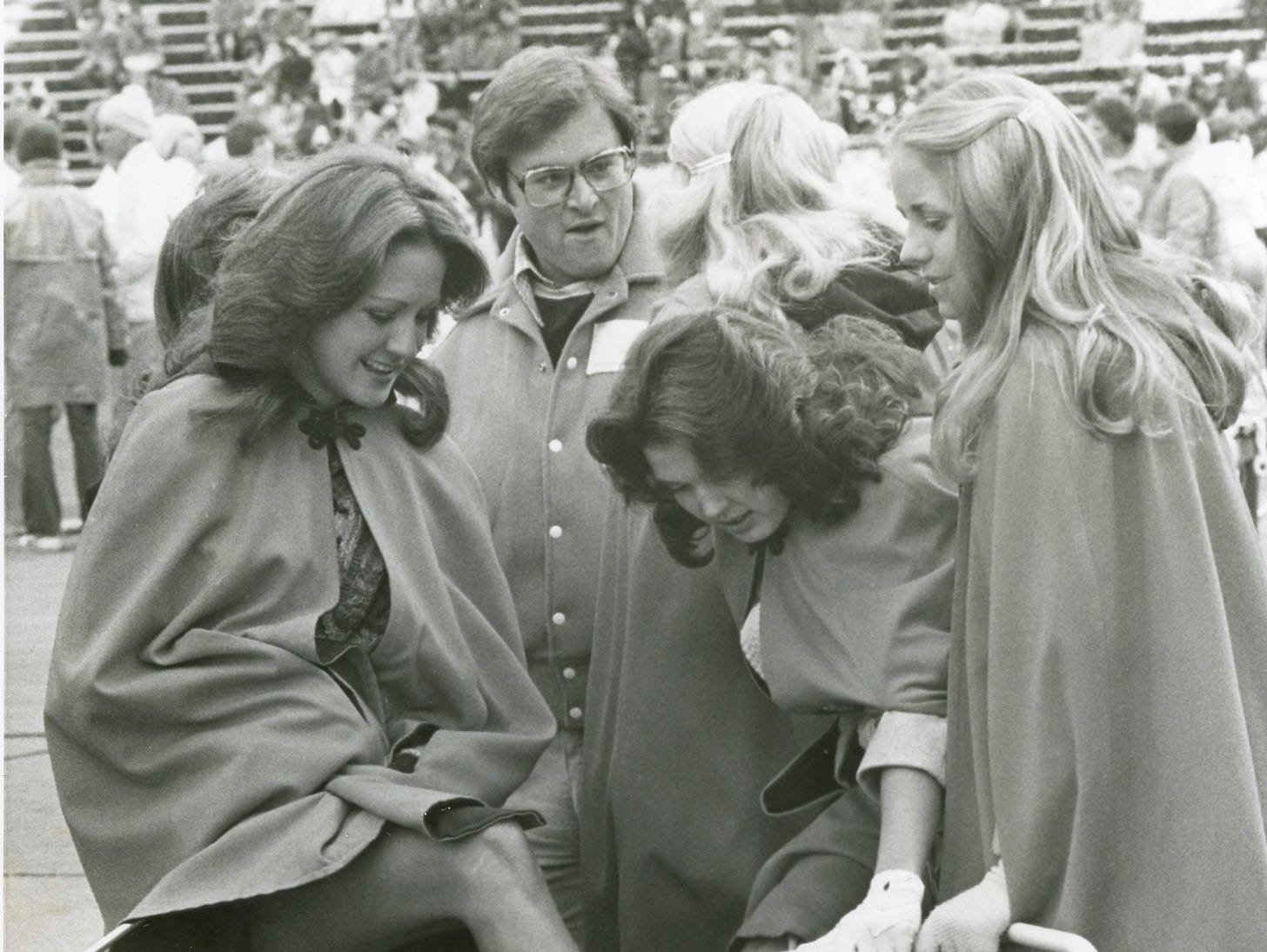 UT majorette Teresa Ray keeps her feet warm on the sidelines during a 1977 football game.