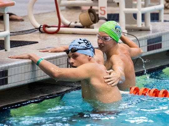 Jack Hamilton of the Peninsula Club is congratulated by Alex Mays of the Green Meadow Swim Team after Hamilton won the 15-18 Boys 50 Yard Backstroke in the Greater Knoxville Area Interclub Swimming Association Championship Swim Meet on Sunday, July 29, 2018 at Allan Jones Aquatic Center.