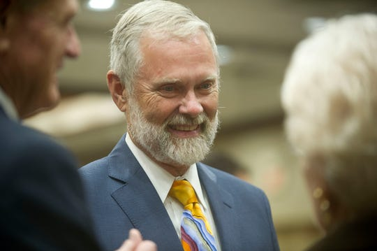 Knox County Commissioner, 8th district, Dave Wright,  mingles with the crowd Thursday, Aug. 4, 2016 at the GOP party at the Crowne Plaza.
