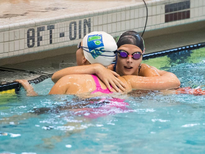 Julia Mason, left, of the Knoxville Racquet Club Swim Team, and Elizabeth Martin of Village Green congratulate each other after competing in the Girls 11-12 50 Yard Backstroke during Greater Knoxville Area Interclub Swimming Association Championship Swim Meet on Sunday, July 29, 2018 at Allan Jones Aquatic Center.