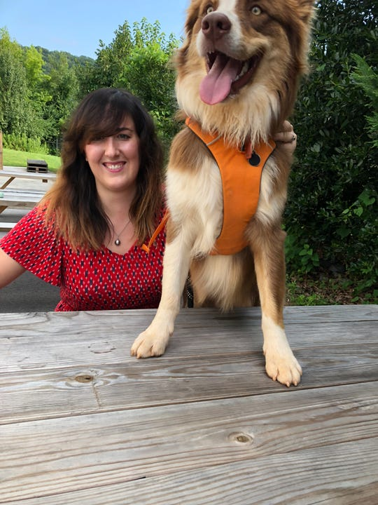 Carey Hodges hangs out with her dog, Agent Dale Cooper, on the patio at Hexagon Brewing Co.