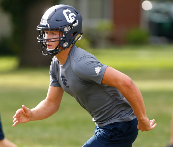 Grant Kennedy runs a kickoff coverage drill during football practice Monday, July 30, 2018, at Central Catholic High School.
