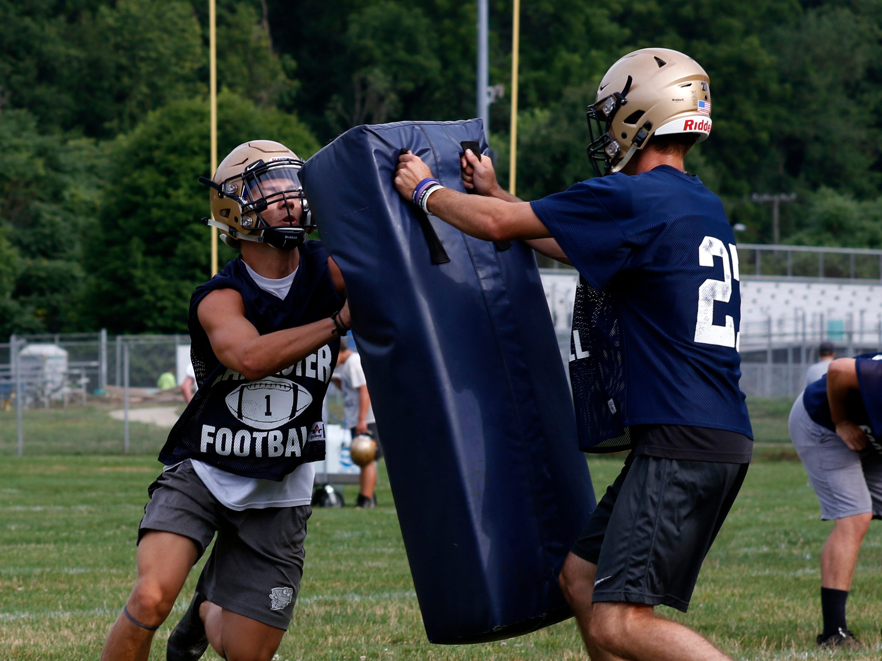 Lancaster football players take part in the first day of a two-a-day practice Monday morning, July 30, 2018, at Lancaster High School.