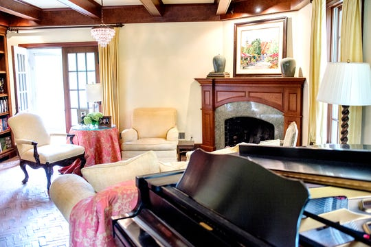 A view of the living room inside Deb Atkinson's historically Colonial home photographed on Tuesday, July 24, 2018, in East Lansing. Built in 1930, the Colonial-style home surrounded by greenery and beautifully renovated is now on the market.
