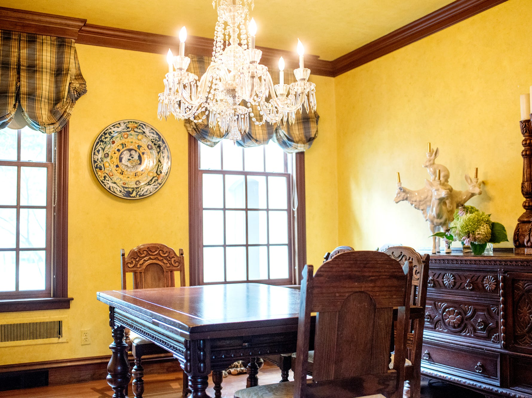 The dining room inside Deb Atkinson's historically Colonial home photographed on Tuesday, July 24, 2018, in East Lansing. Built in 1930, the Colonial-style home surrounded by greenery and beautifully renovated is now on the market.