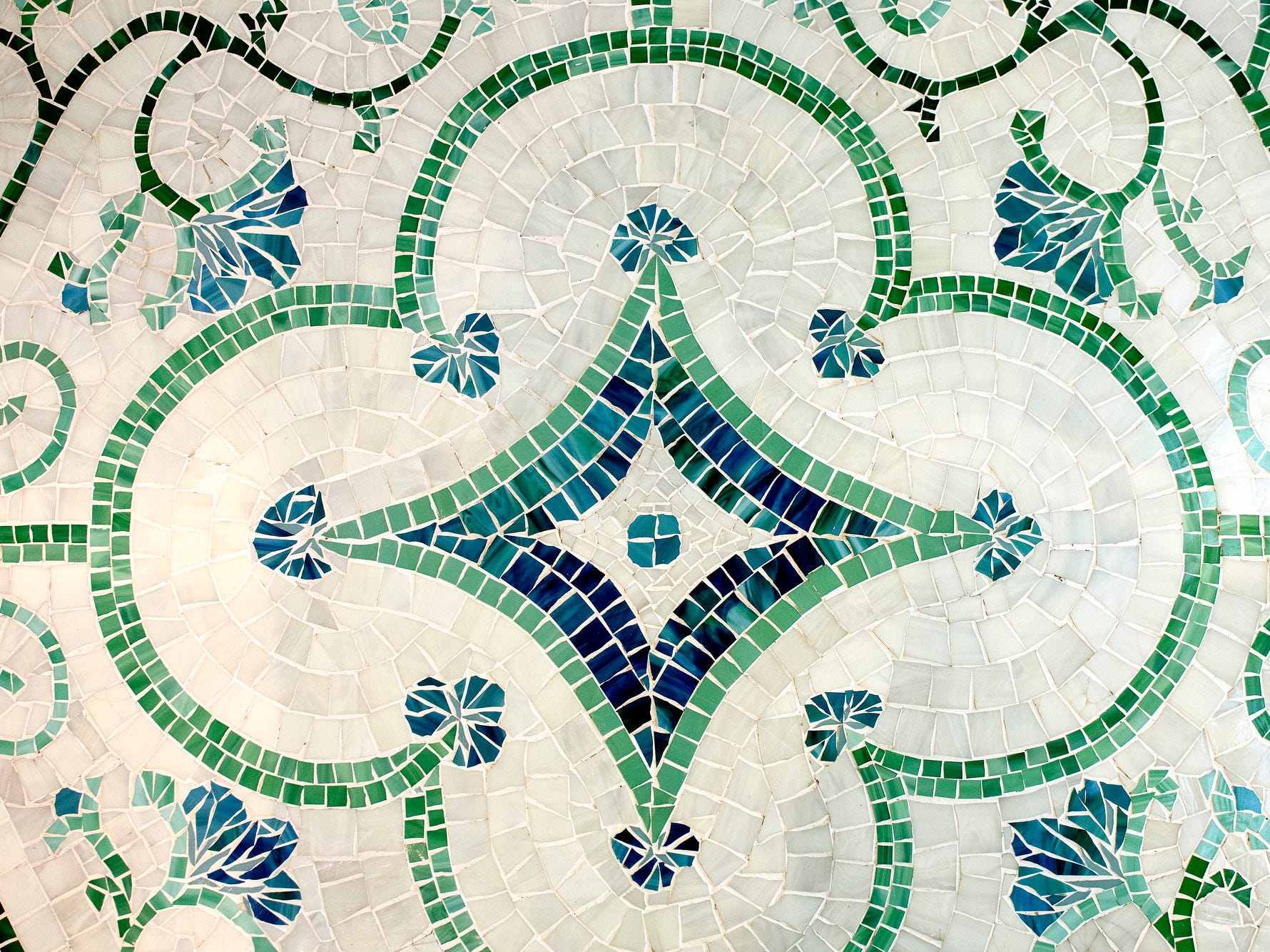 One of several of Deb Atkinson's mosaics is seen in the floor of the master suite bathroom inside the historically Colonial home photographed on Tuesday, July 24, 2018, in East Lansing. Built in 1930, the Colonial-style home surrounded by greenery and beautifully renovated is now on the market.