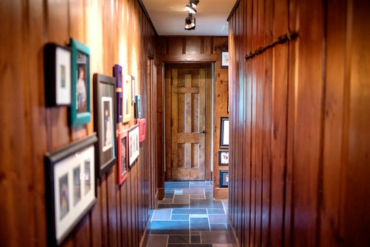 Knotty Pine taken from the main level now lines the upstairs hallway inside Deb Atkinson's historically Colonial home photographed on Tuesday, July 24, 2018, in East Lansing. Built in 1930, the Colonial-style home surrounded by greenery and beautifully renovated is now on the market.