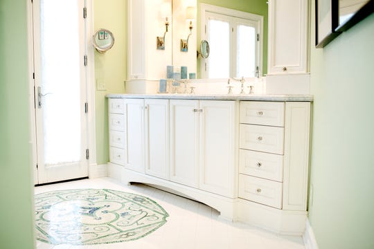 The bathroom in the master suite inside Deb Atkinson's historically Colonial home photographed on Tuesday, July 24, 2018, in East Lansing. Built in 1930, the Colonial-style home surrounded by greenery and beautifully renovated is now on the market.