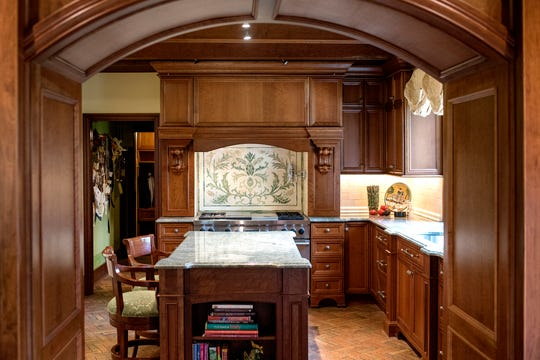 A look at the kitchen inside Deb Atkinson's historically Colonial home photographed on Tuesday, July 24, 2018, in East Lansing. Built in 1930, the Colonial-style home surrounded by greenery and beautifully renovated is now on the market.