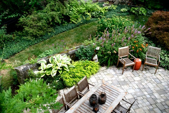 A view of the backyard from the second level of Deb Atkinson's historically Colonial home photographed on Tuesday, July 24, 2018, in East Lansing. Built in 1930, the Colonial-style home surrounded by greenery and beautifully renovated is now on the market.