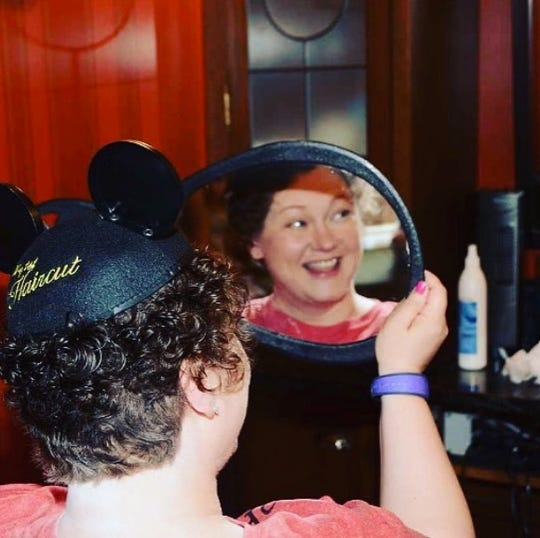 Jackie Bradway receives her first post-cancer treatment haircut at Disney World in 2016.