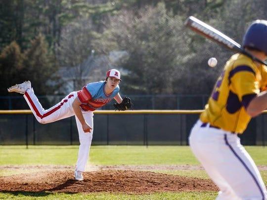 Arrowhead pitcher Davis Zeutzius delivers a pitch.