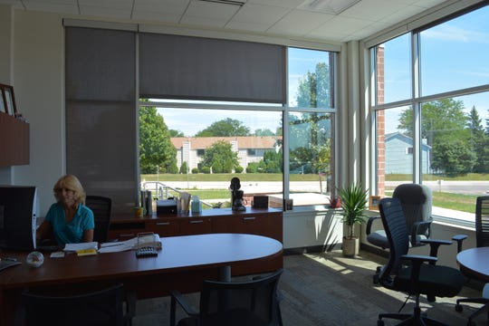 Sharon Mueller, director of finance and administration, sits in one of the four offices with corner windows in the new Muskego City Hall. Plans had called for more corner offices elsewhere, but the city scaled back as a money-saving approach, according to the mayor.