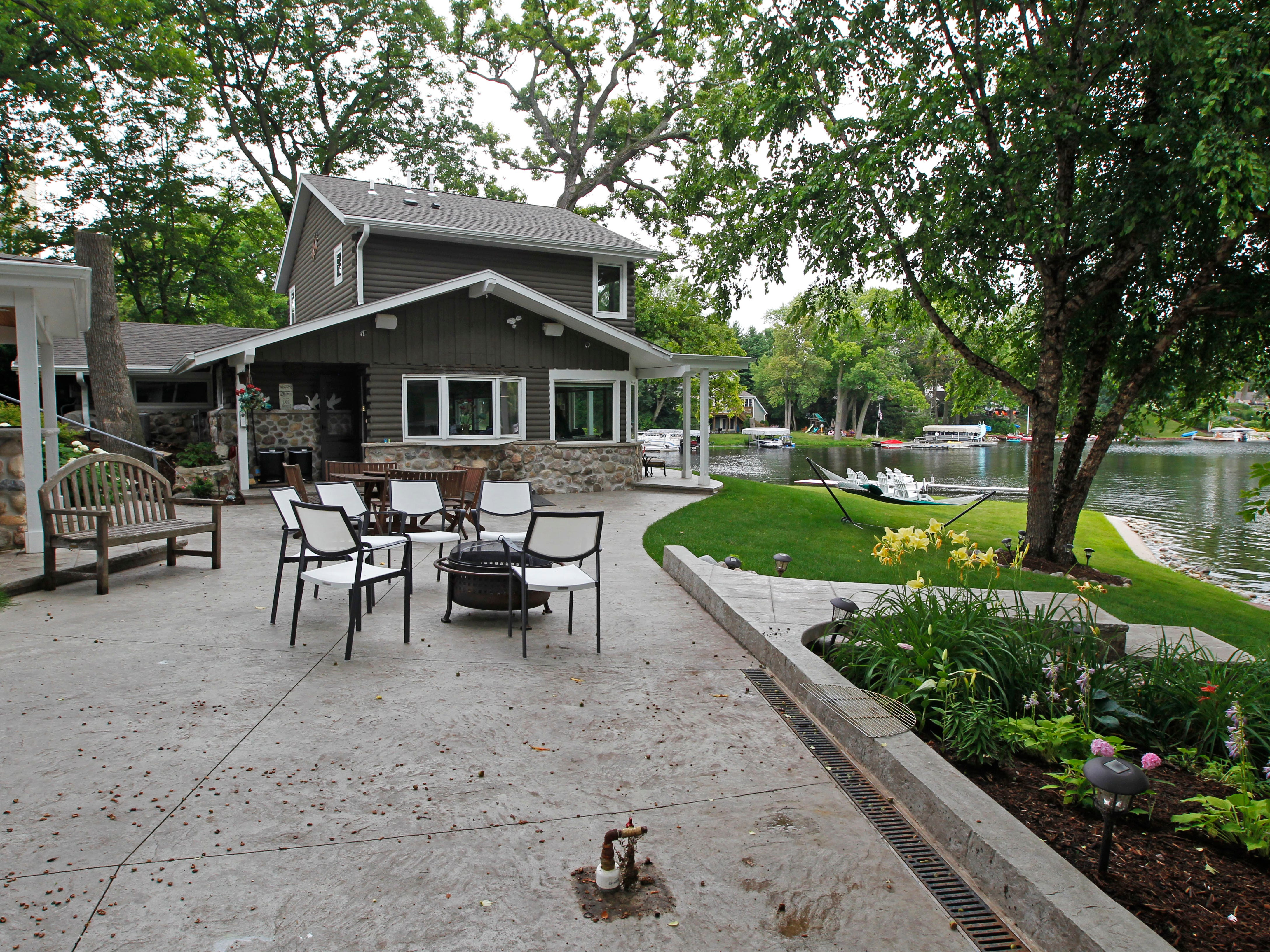 The Phillips' lake house outdoor seating is spacious and offers a variety of spots for entertaining.