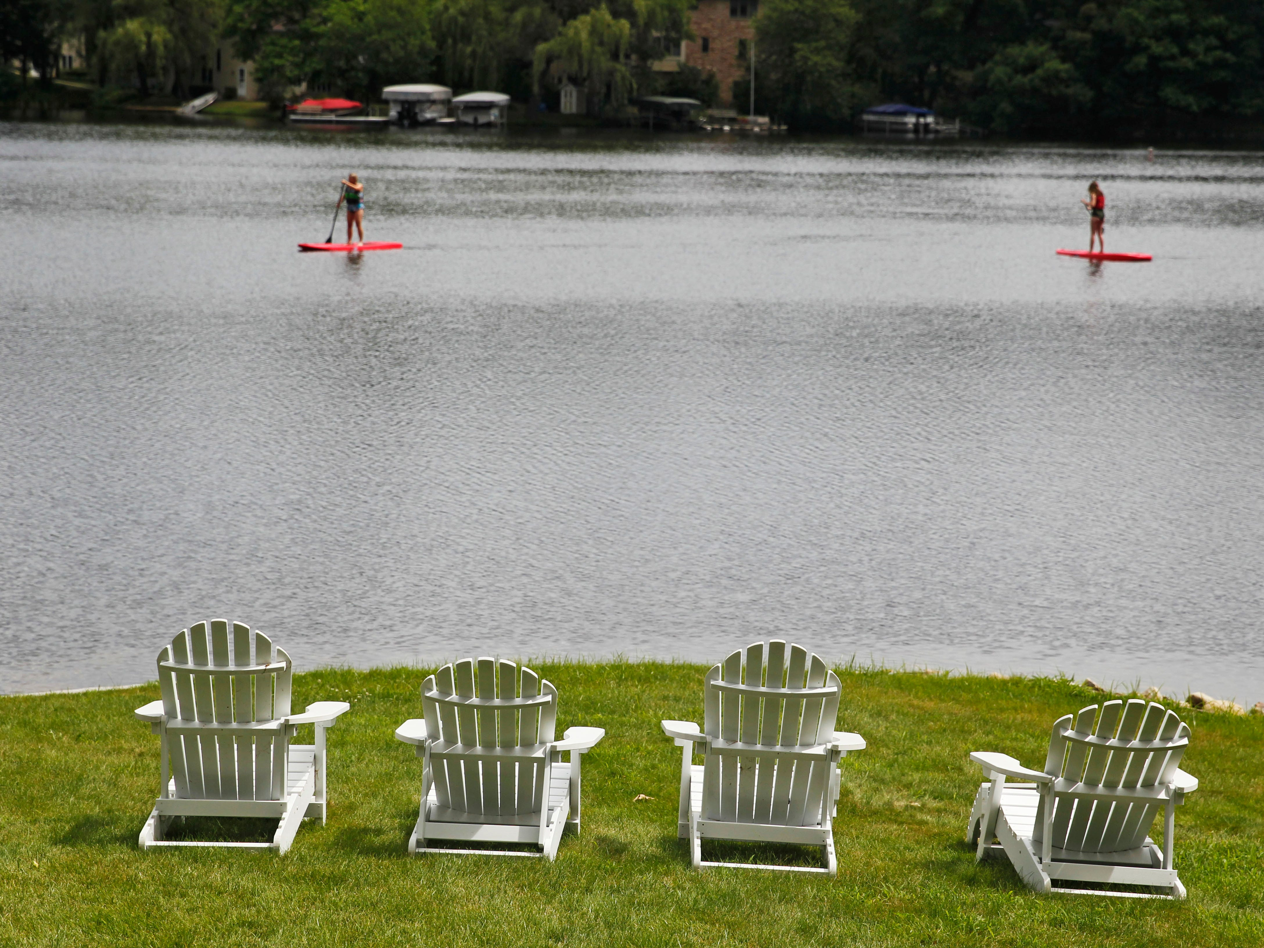 Adirondack chairs make for a perfect spot to view lake activities.