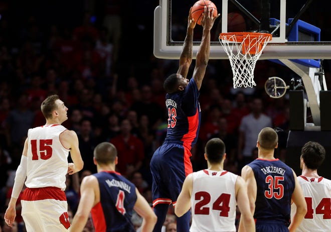 An Arizona Wildcats fan went to great extremes to see his team on cable while visiting Lake Delton, police say.