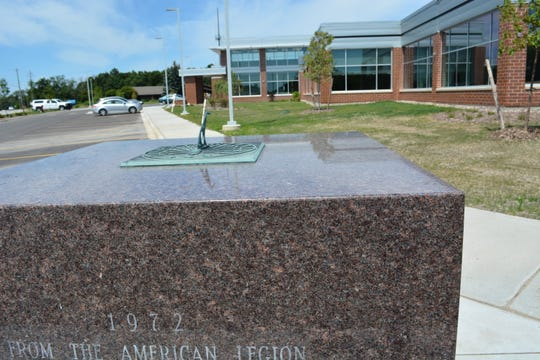 As seen from the old American Legion cornerstone, the new city hall reveals plenty of glass, a feature employees wanted, according to city officials. The old building had fewer and smaller windows.