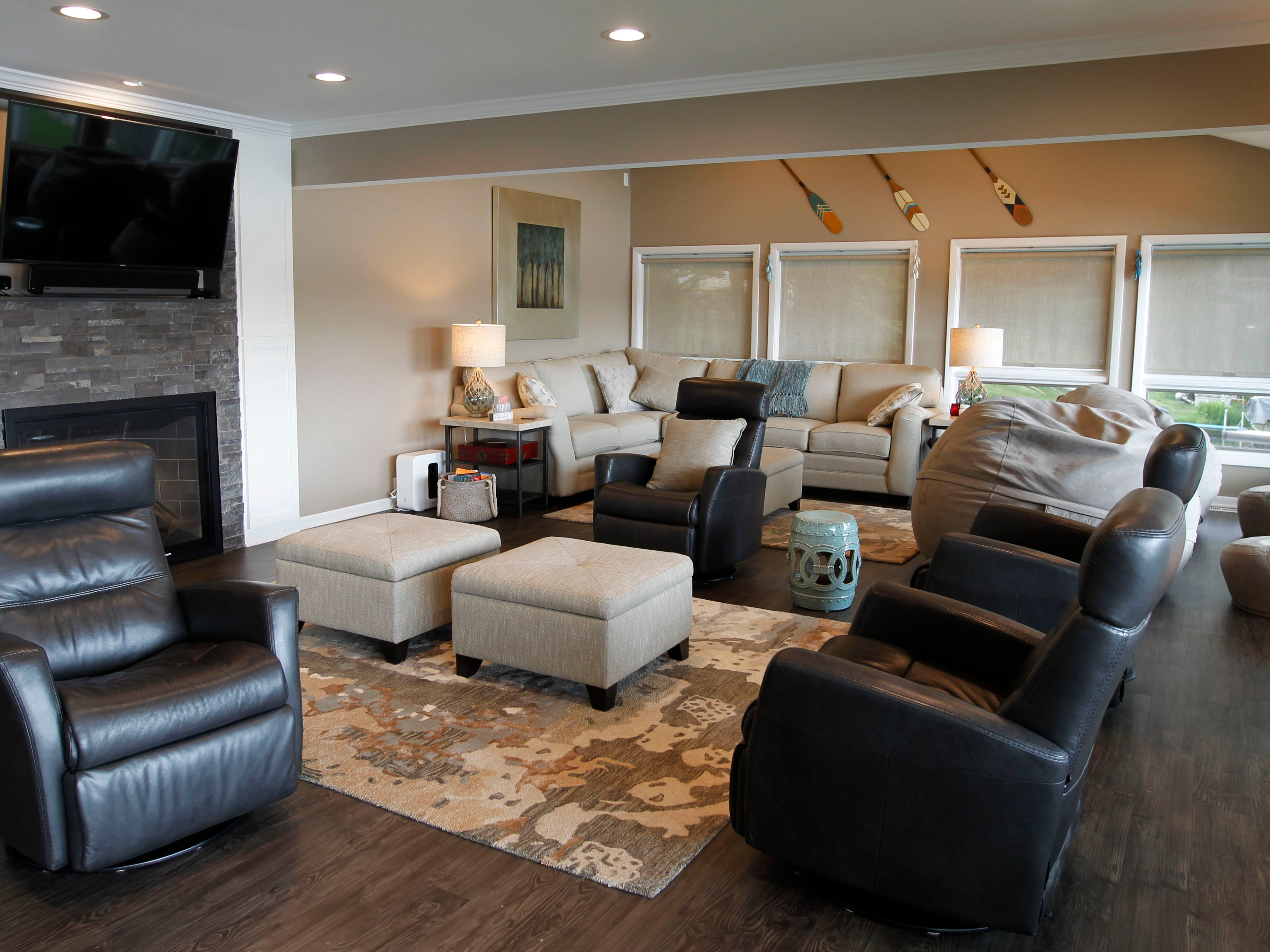The Phillips family room in Okauchee is open with lots of cozy seating for viewing the inlet bay within Okauchee Lake.