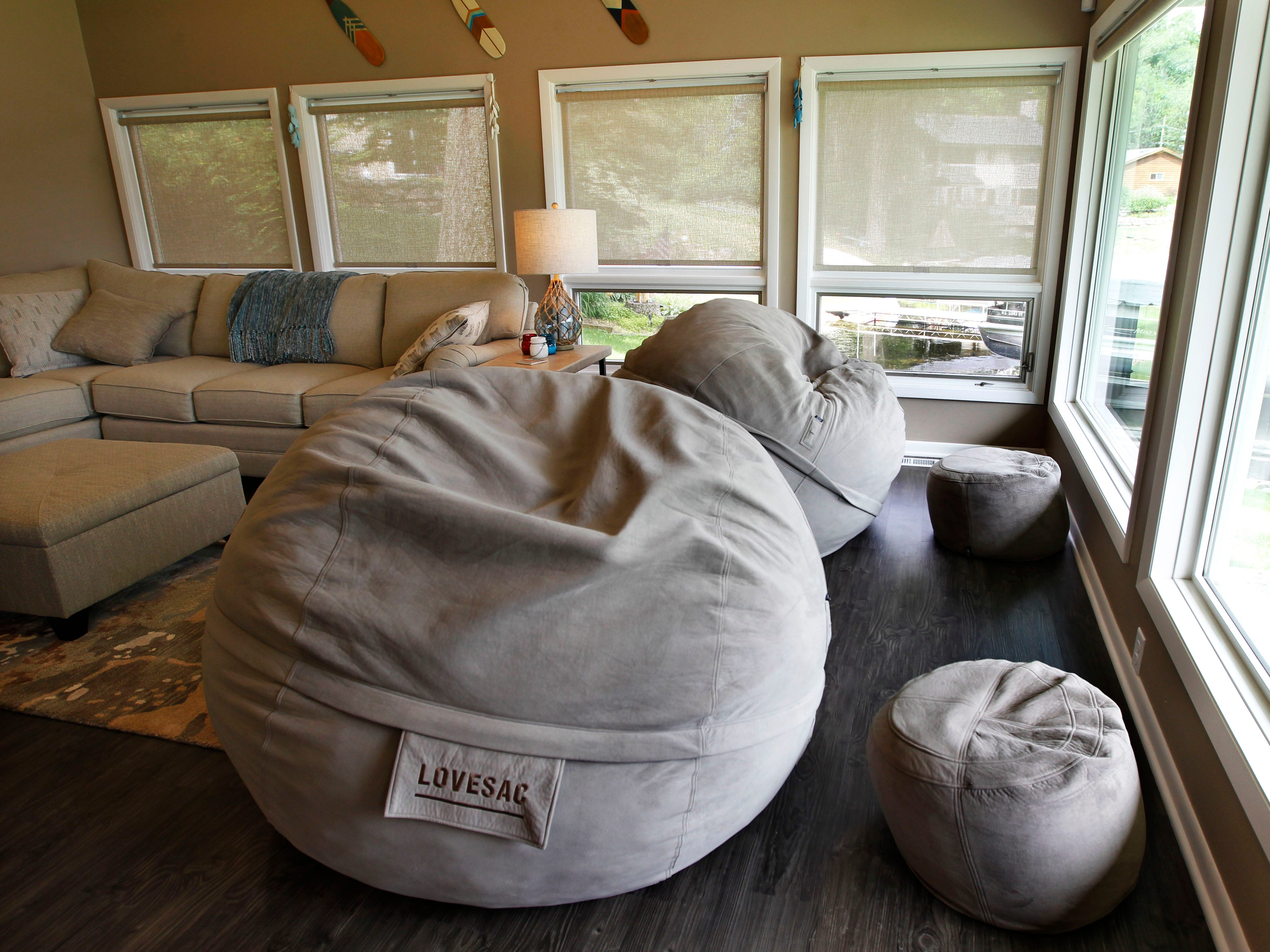 Matching LoveSac bean bags offer  cozy and comfy seating in the family room.