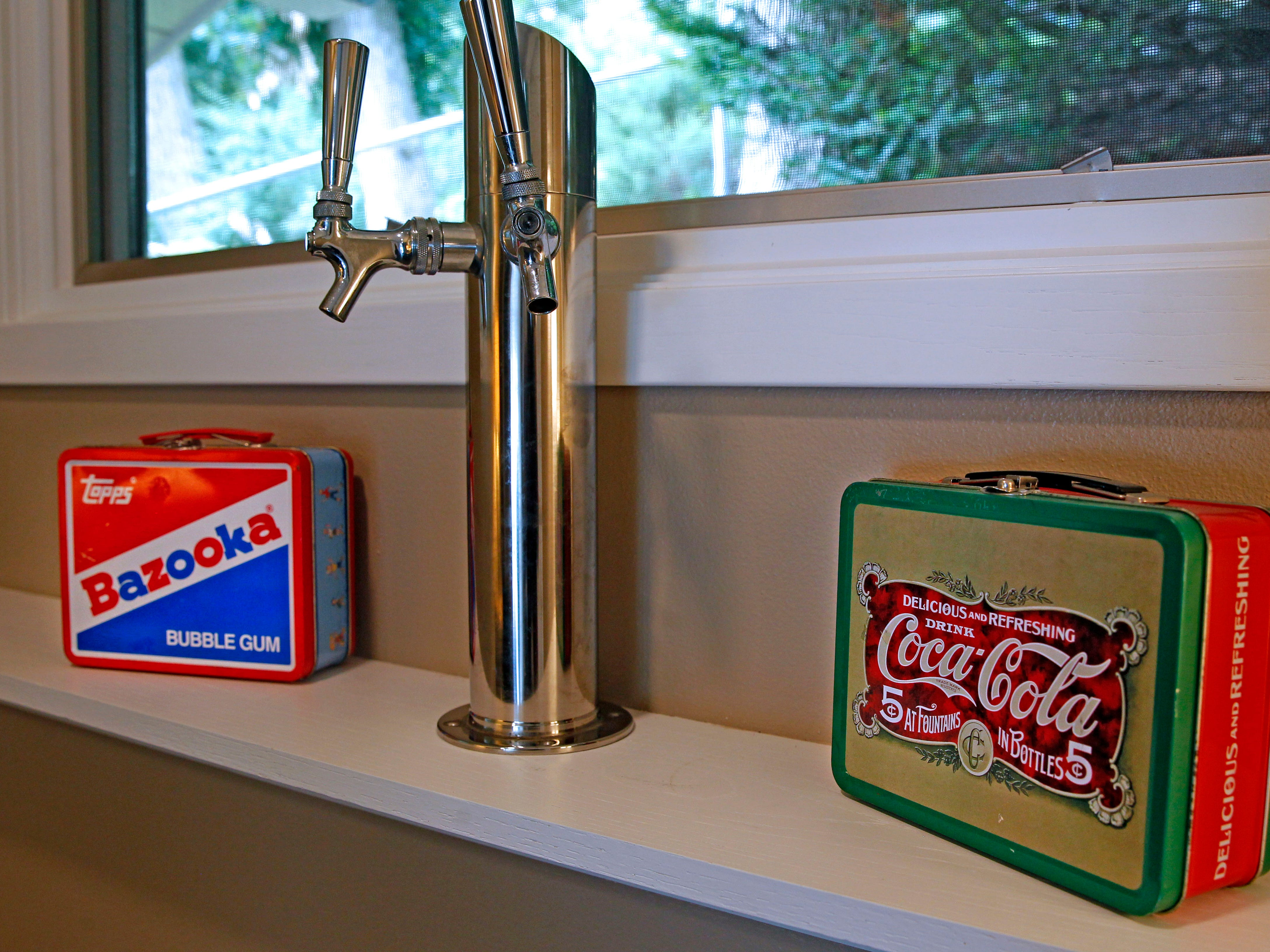 Vintage lunchboxes are part of the decor in an office window at the  Phillips family lake house.