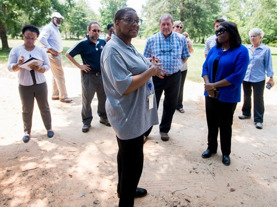 Sherry Bradley, of the state health department speaks as Congresswomen Terri Sewell takes a group of engineering and health experts to homes with sewage problems in Lowndes County, Ala., on Monday, July 30, 2018.