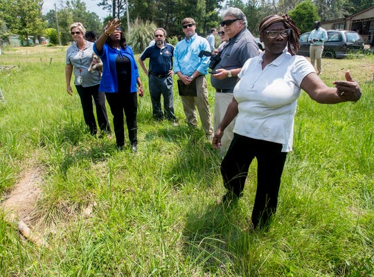 Homeowner Bonnie Bryant, right, shows a failed homemade septic tank, left, on her property in Farmersville, Ala., as Congresswomen Terri Sewell takes a group of engineering and health experts to homes with sewage problems in rural Lowndes County on Monday, July 30, 2018.