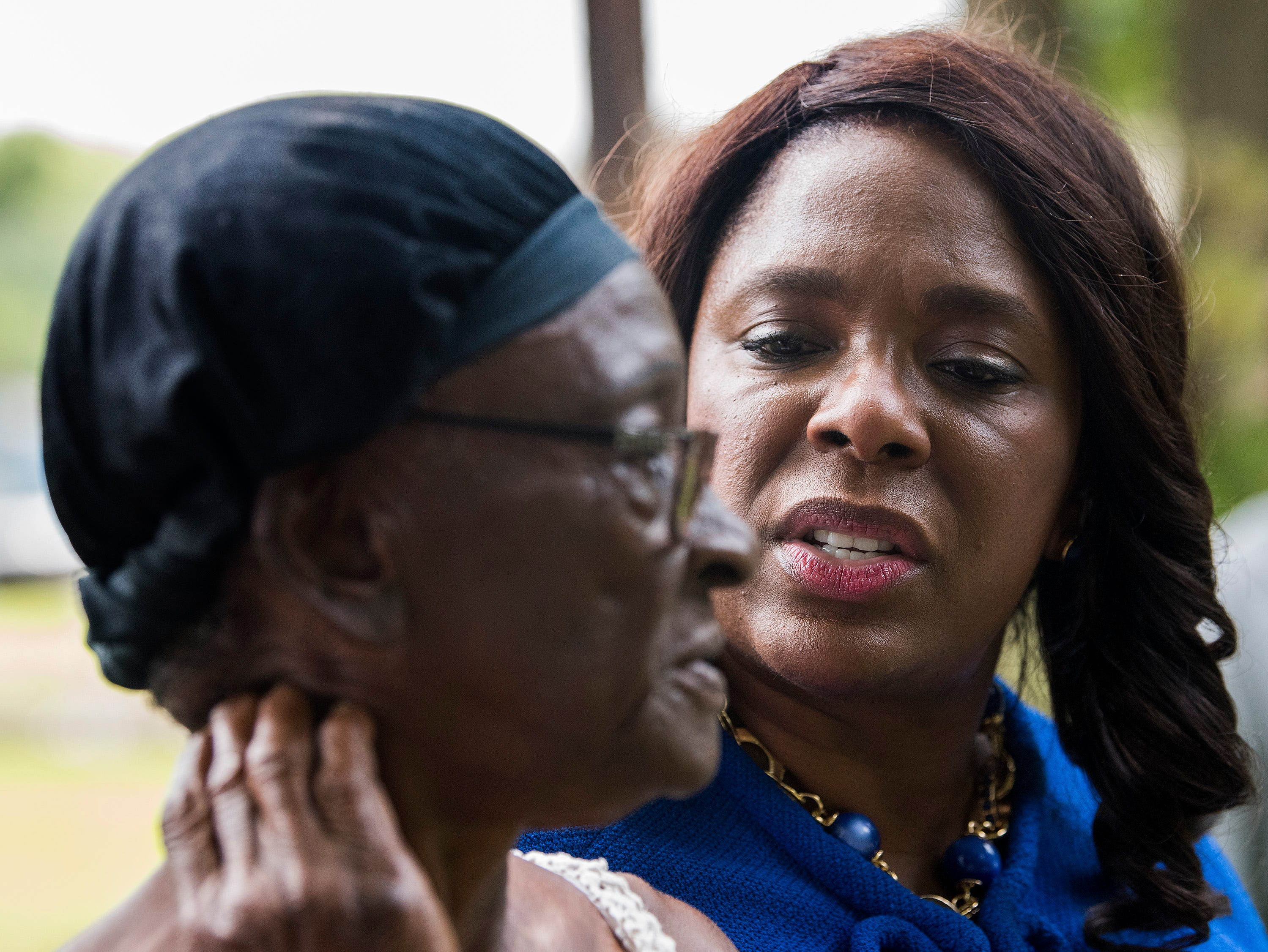 Congresswomen Terri Sewell talks with homeowner Willie Mae Spivey, who recentley get a new free septic tank, as Sewell takes a group of engineering and health experts to homes with sewage problems in Lowndes County, Ala., on Monday, July 30, 2018.
