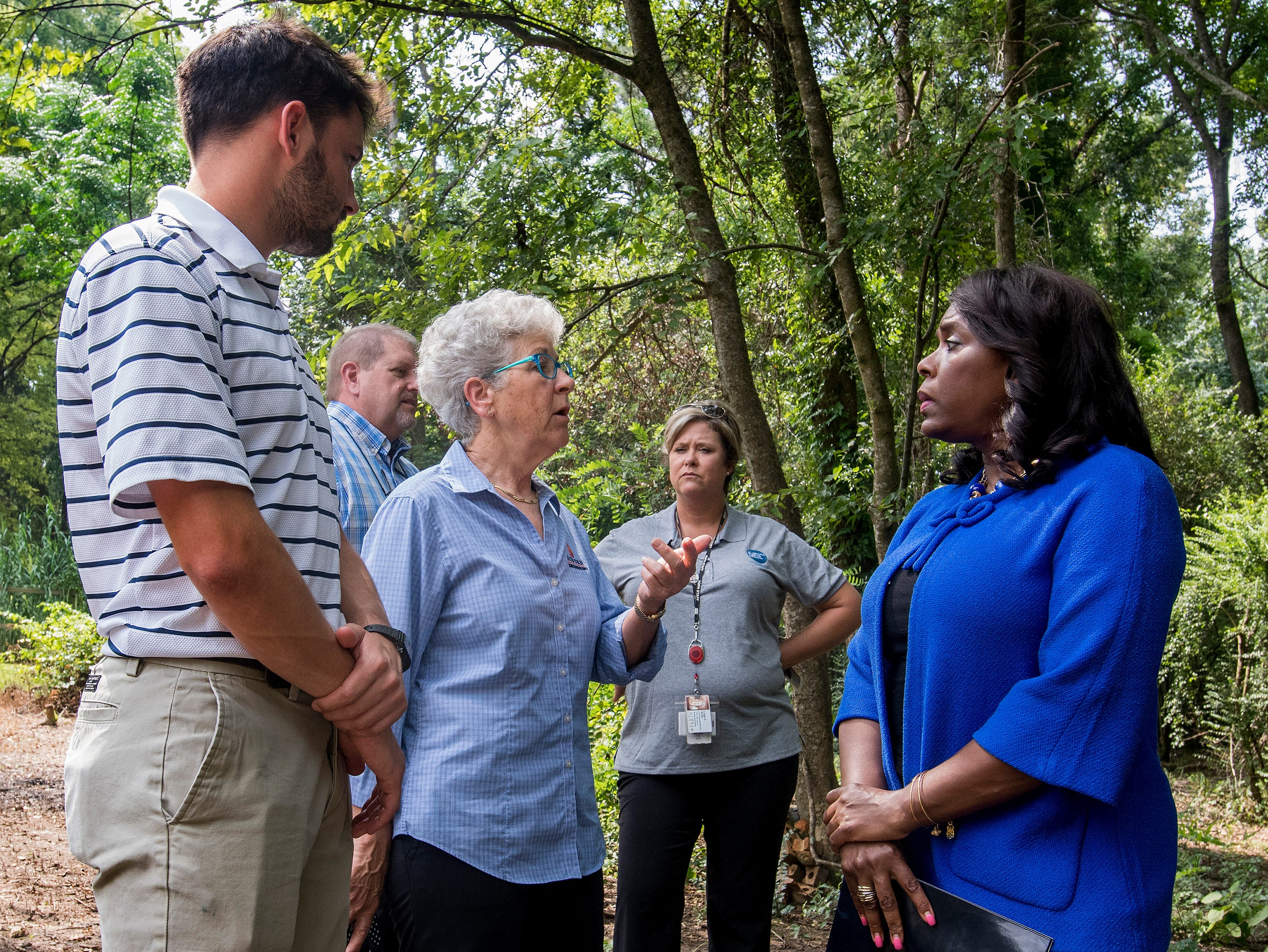Congresswomen Terri Sewell takes a group of engineering and health experts to homes with sewage problems in Lowndes County, Ala., on Monday, July 30, 2018.
